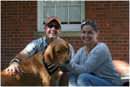 Kevin and his wife Lisa with their service dog, Bella.