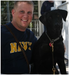 Ryan with his service dog, Spirit.